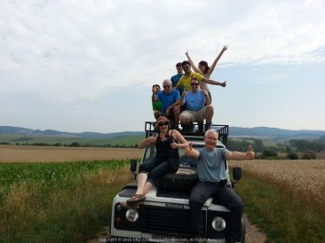 Atop a vintage Land Rover in the Slovakian Fields with my UK hiking friends