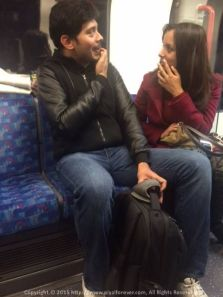 Cousins in deep discussion in the London Underground - What do you think the weather will be tomorrow?