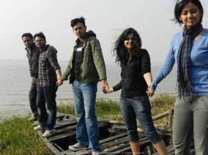 Hand in hand Sudipto, Kalyan, myself, Poulomi and Minakshi on a boat during a Kolkata Office picnic